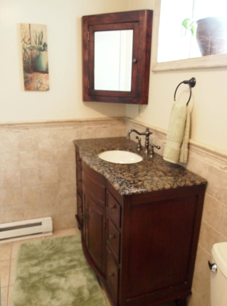Donna Michaels -downstairsbathroom, made corner cabinet, installed vanity, tile, heater, paint, plumbing
